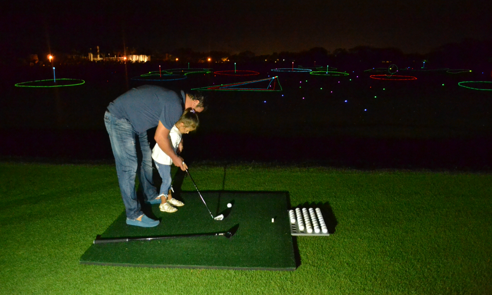 Dad and Daughter — Night Golf Here to Stay